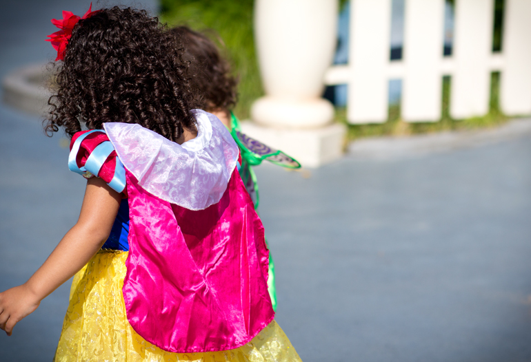 A Candid Photograph of a Cute Young Girl Dressed as Snow White in Toontown at Disneyland