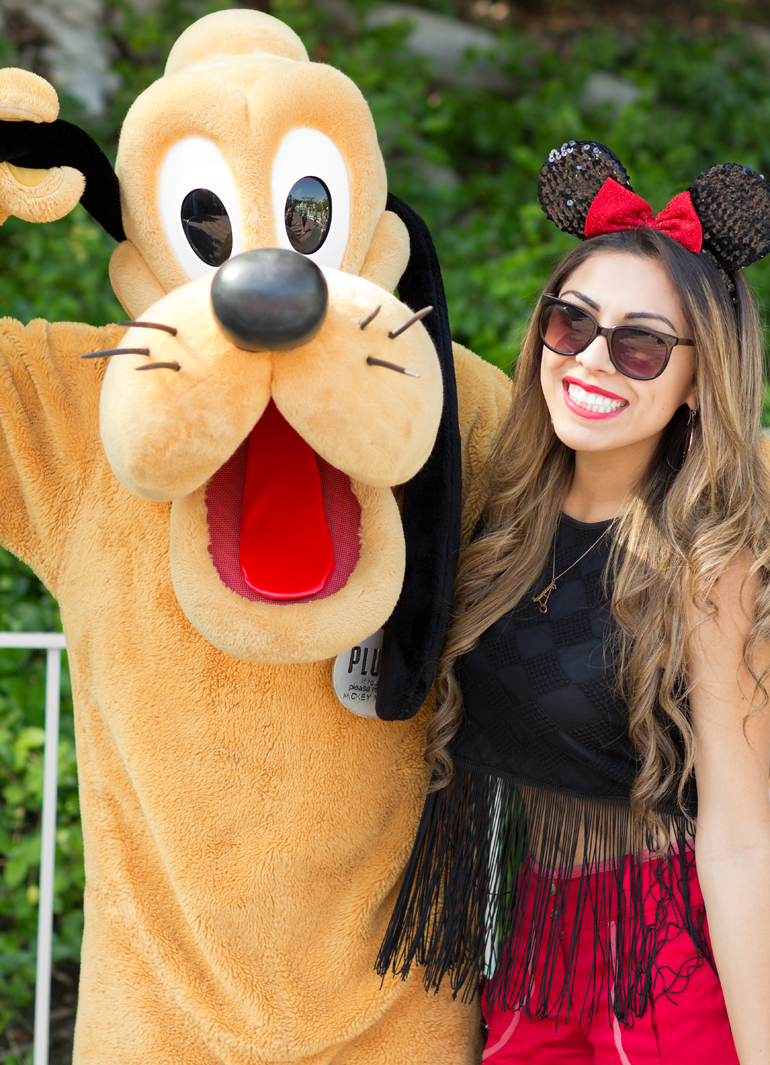Alexis Alcala Posing with Pluto in Toontown at Disneyland