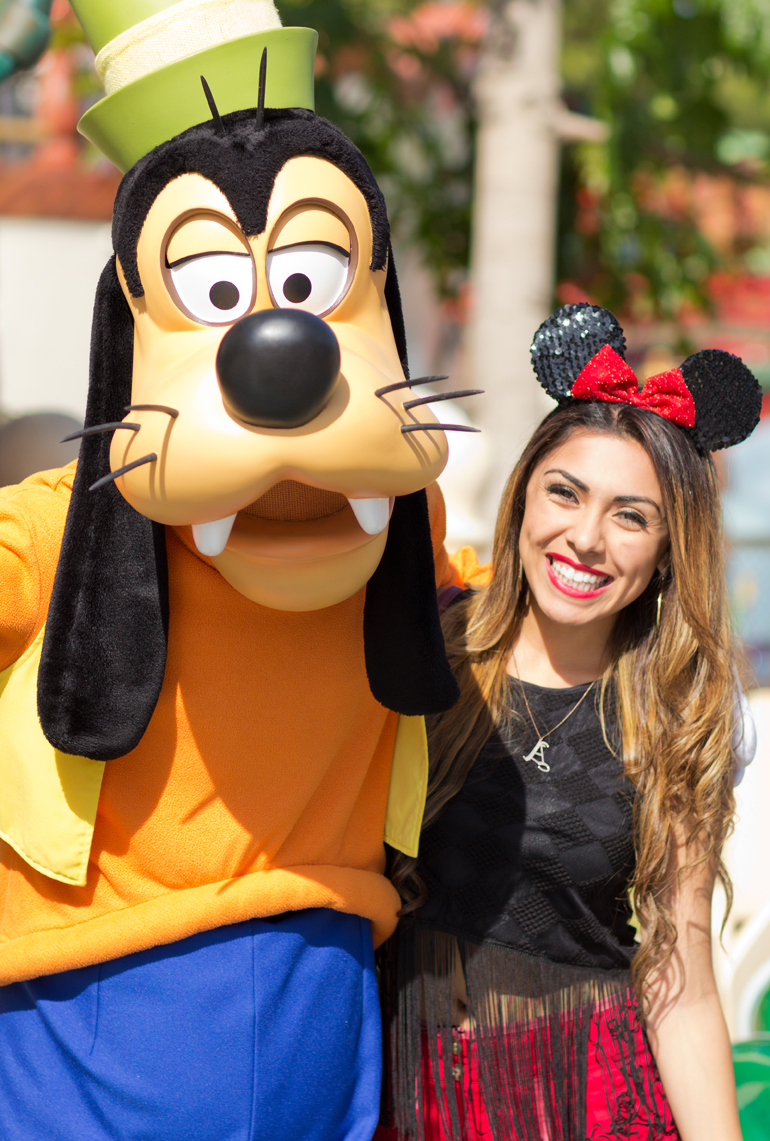 Alexis Alcala Posing with Goofy, Her Favorite Disney Character, in Toontown at Disneyland