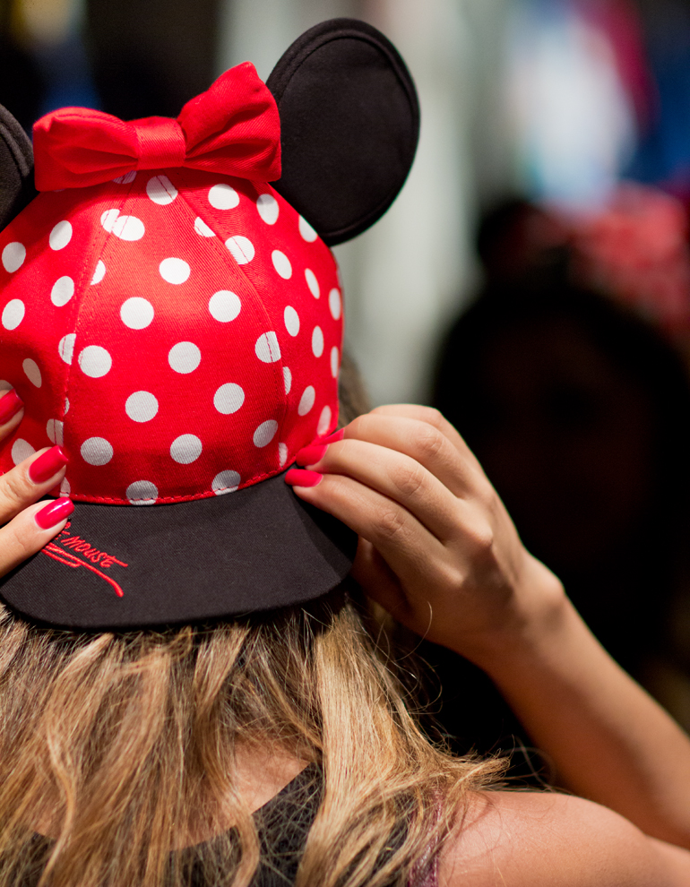 Alexis Alcala Trying on a Minnie Mouse Hat in Critter Country at Disneyland