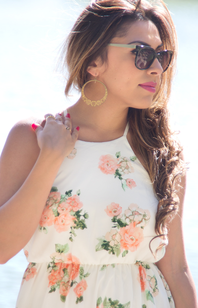 A Photo of Alexis Alcala at Yorba Regional Park as She Models a Floral Dress for Her Blog