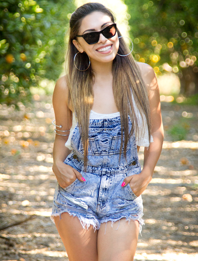 Alexis Alcala Posing in an Orange Grove in Denim Overalls